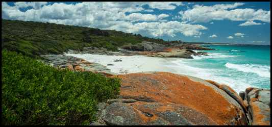 Secluded Beach among lichen covered rocks, north of The Gardens, Bay of Fires, Tasmania