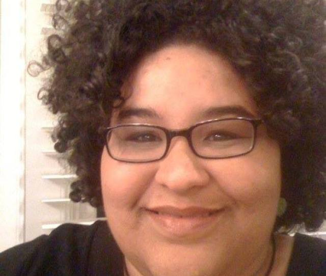 Image Description The Photograph Shows The Author A Biracial Woman With Curly Black Hair And Black Rimmed Glasses She Is Wearing A Pendant And A Black