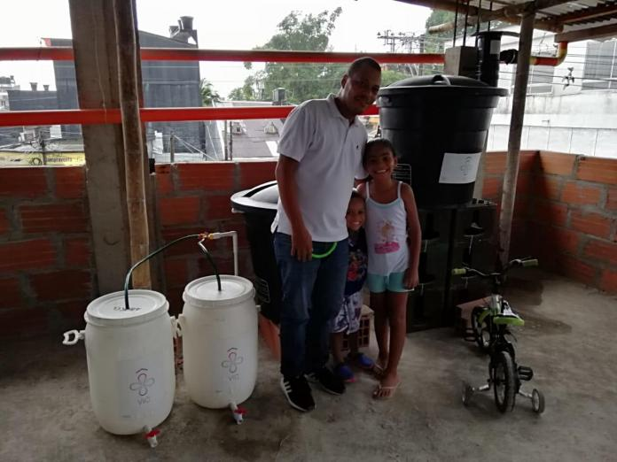 Environmental activist and head of Escuela Robótica de Chocó, Jimmy García with the water filters for rainwater harvesting.