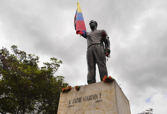 His statue close to Corferias. On the 20th anniversary of the murder many people visited the monument, took pictures, left flowers and gave him a flag. Photo: Steve Hide