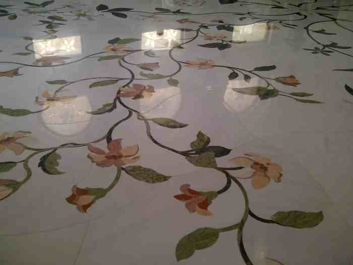 Floral mosaic on white marble floor