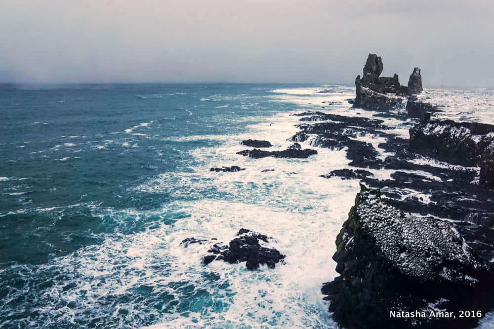 Londrangar- West Iceland Highlights- Snaefellsnes Peninsula: Remote and dramatic landscapes minus the crowds of the South Coast of Iceland, the Snaefellsnes Peninsula should be a must-do on your Iceland itinerary.