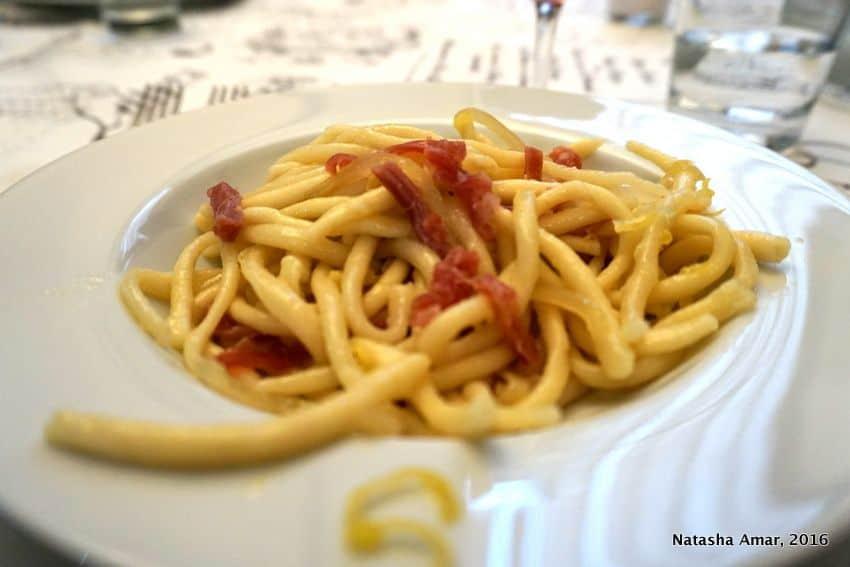 strozzapretti pasta in Bologna, Italy