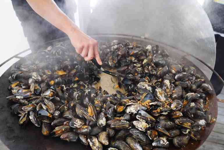 Mussels being cooked in a large pan at Musselbaren Ljungskile in West sweden