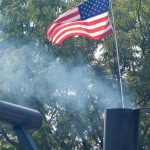 Flag and smoke at the Rock ;n Brews & BBQ Festival in Boise
