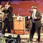 Jake singing with Elwood on Harp
