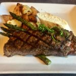 New York Steak and roasted potatoes plate