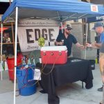 Passing out beer tastes at Edge Brewing