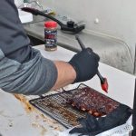 Putting on BBQ sauce at Twisted Blue Smoke BBQ