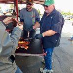 Tasting a pork rib at Owhyhee BBQ