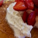 Strawberries on pancakes closeup