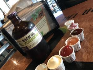 Kombucha bottle and sauces at BFC