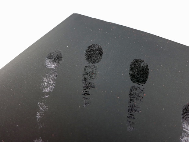 black book with fingerprints