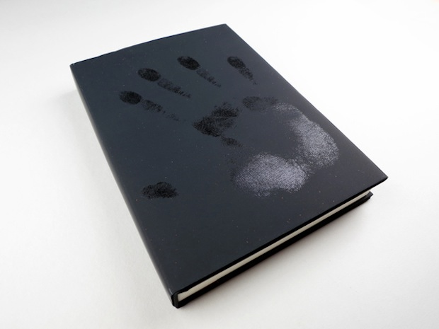 black book with a hand print