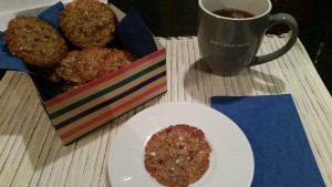 Florentines in a colored box with one on a place and a cup of tea.