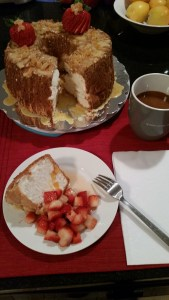 Plated slice with sliced cake and coffee in background