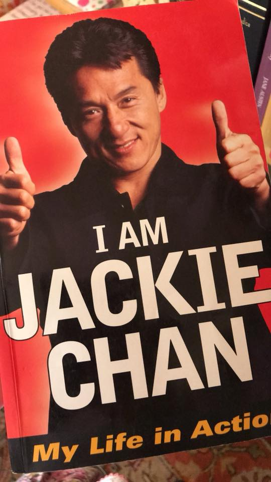 Image may contain: 1 person, smiling, text that says 'JACKIE I AM CHAN My Life in Actio'