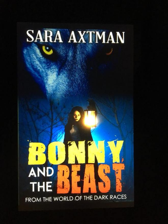 Image may contain: 1 person, text that says 'SARA AXTMAN BONNY AND BEAST THE FROM THE WORLD OF THE DARK RACES'