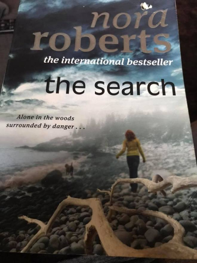 Image may contain: text that says 'nora roberts the international bestseller the search Alone in the woods surrounded by danger..'