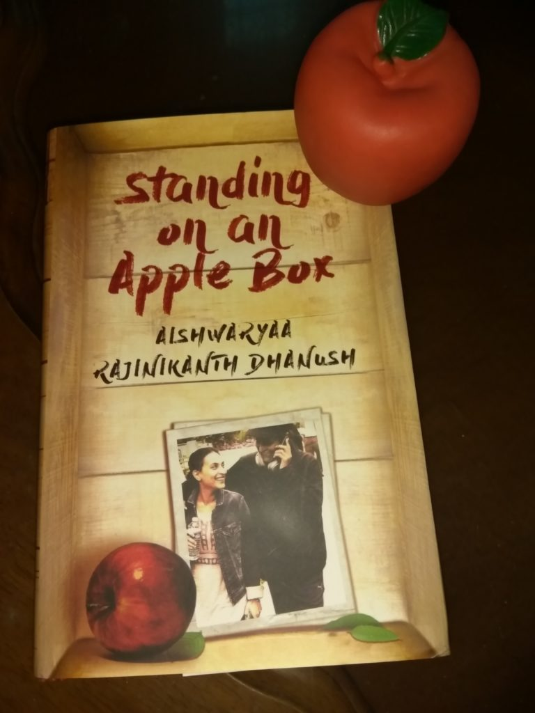Standing on an apple box by Aishwarya