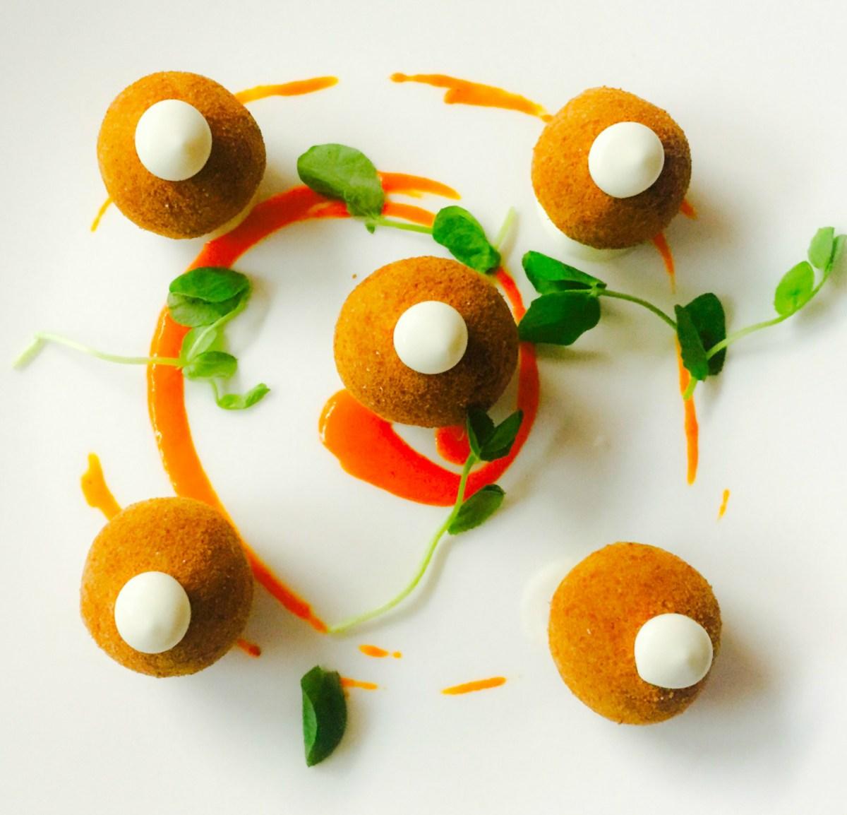 Cod Fish Croquettes: sweet piquillo pepper purée, pea tendrils, lemon aioli