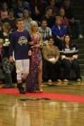 Photo by: Nicaila Mata --- Freshman Alli Thompson walks with her escort Casey Smith.