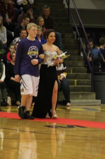 Photo by: Nicaila Mata --- Sophomore Jessica Silakowski walks with her escort Isaiah Barber.