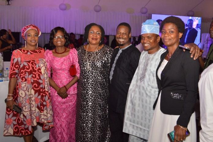 Mrs. Joy Shobanjo with Bolaji Okusaga (middle) in cross section of photograph