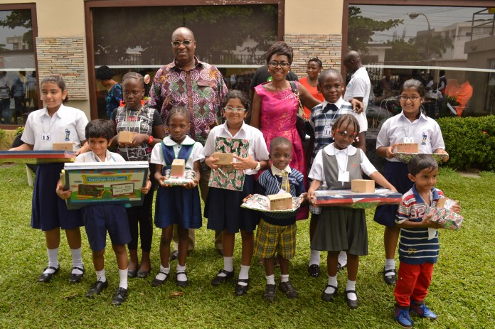 Dr, Tunde Filani and Mrs. Victoria Tandoh with the WINNERS of the children Art competition