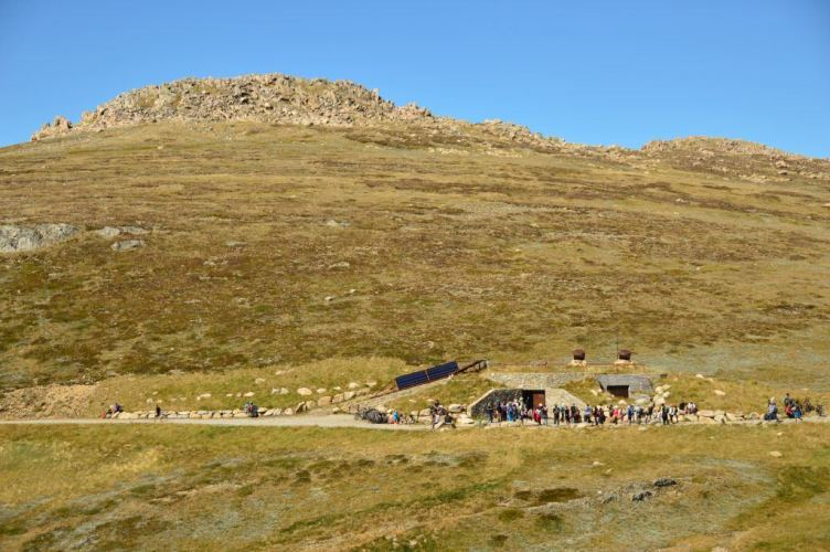 a long view of people lined up to use australia's highest toilet mount kosciuszko