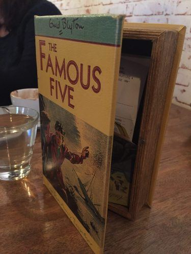 famous five branded box with bill on a table at central road cafe thredbo