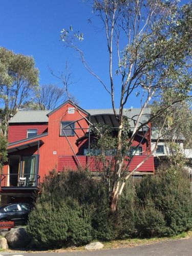 exterior view of a red chalet thredbo village new south wales australia