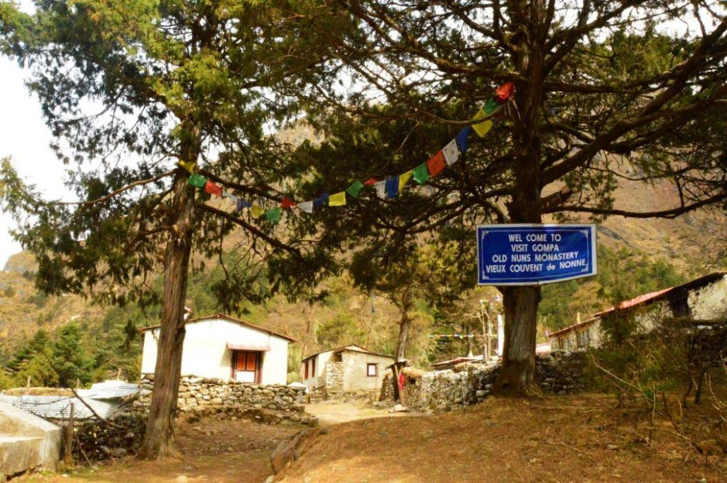 buildings with sign for home for old nuns on everest base camp trek