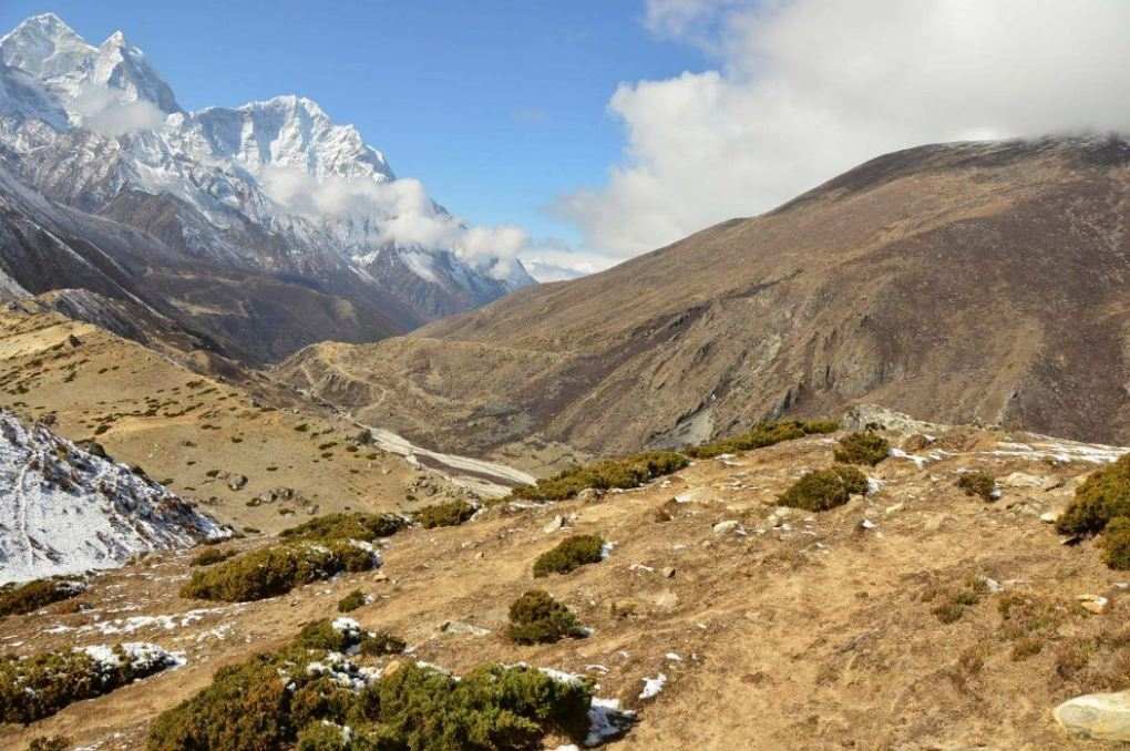 view along the everest base camp trek on the seventh day leaving Dingboche