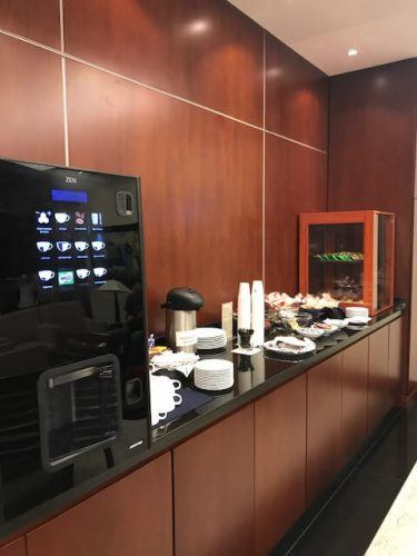 wood panelled coffee and snacks area business class lounge medellin airport