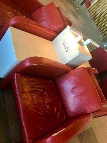 red seats and table iberia airlines business class lounge madrid airport