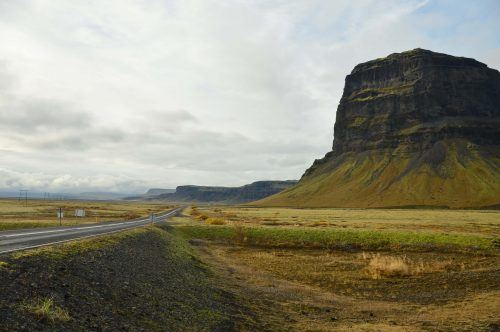 tall mountain along the road in iceland
