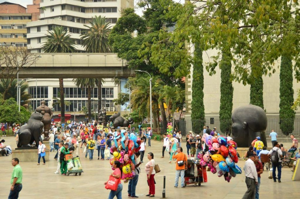 people and sculptures in plaza botero medellin