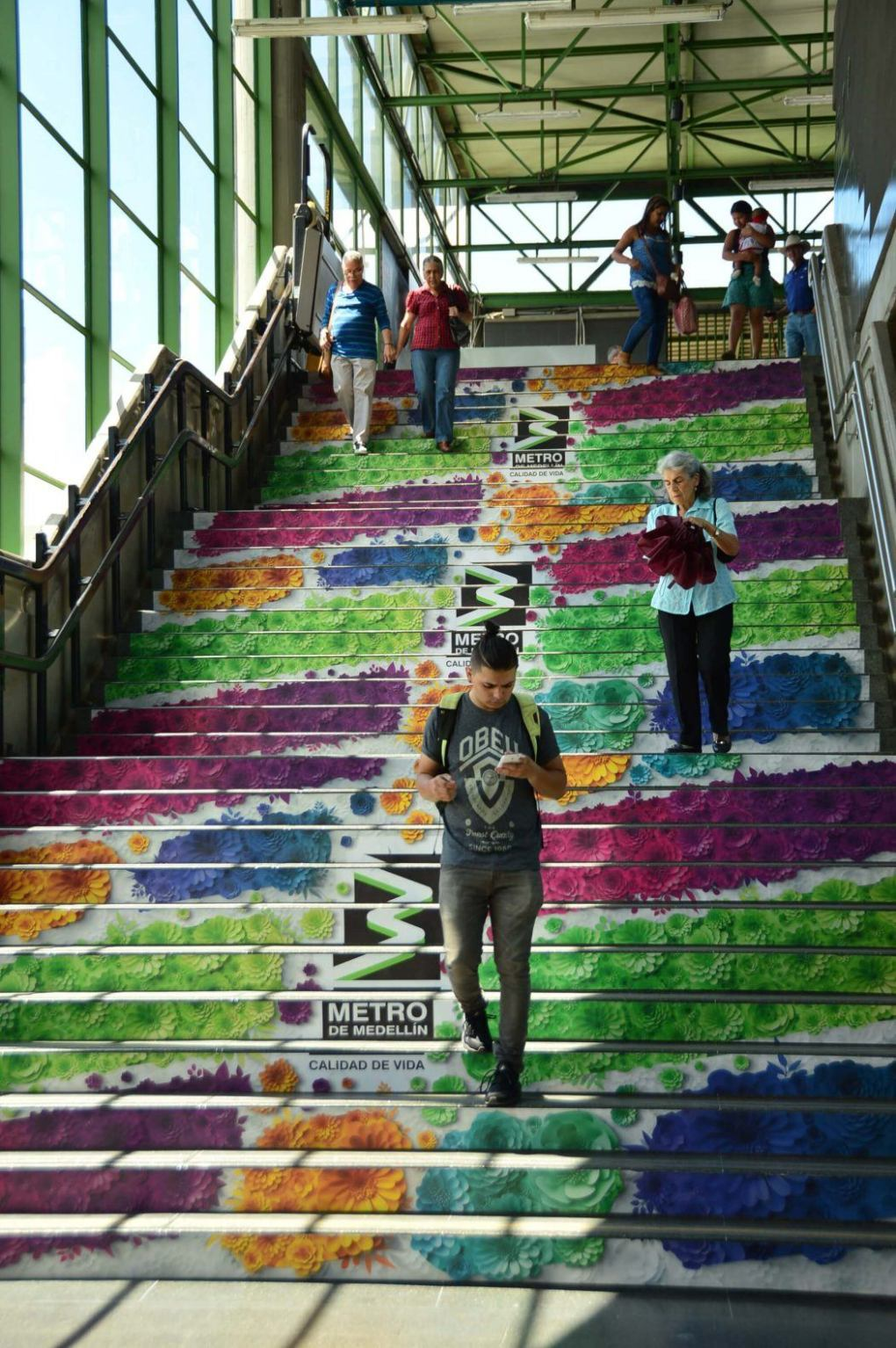 steps of medellin metro decorate with floral images