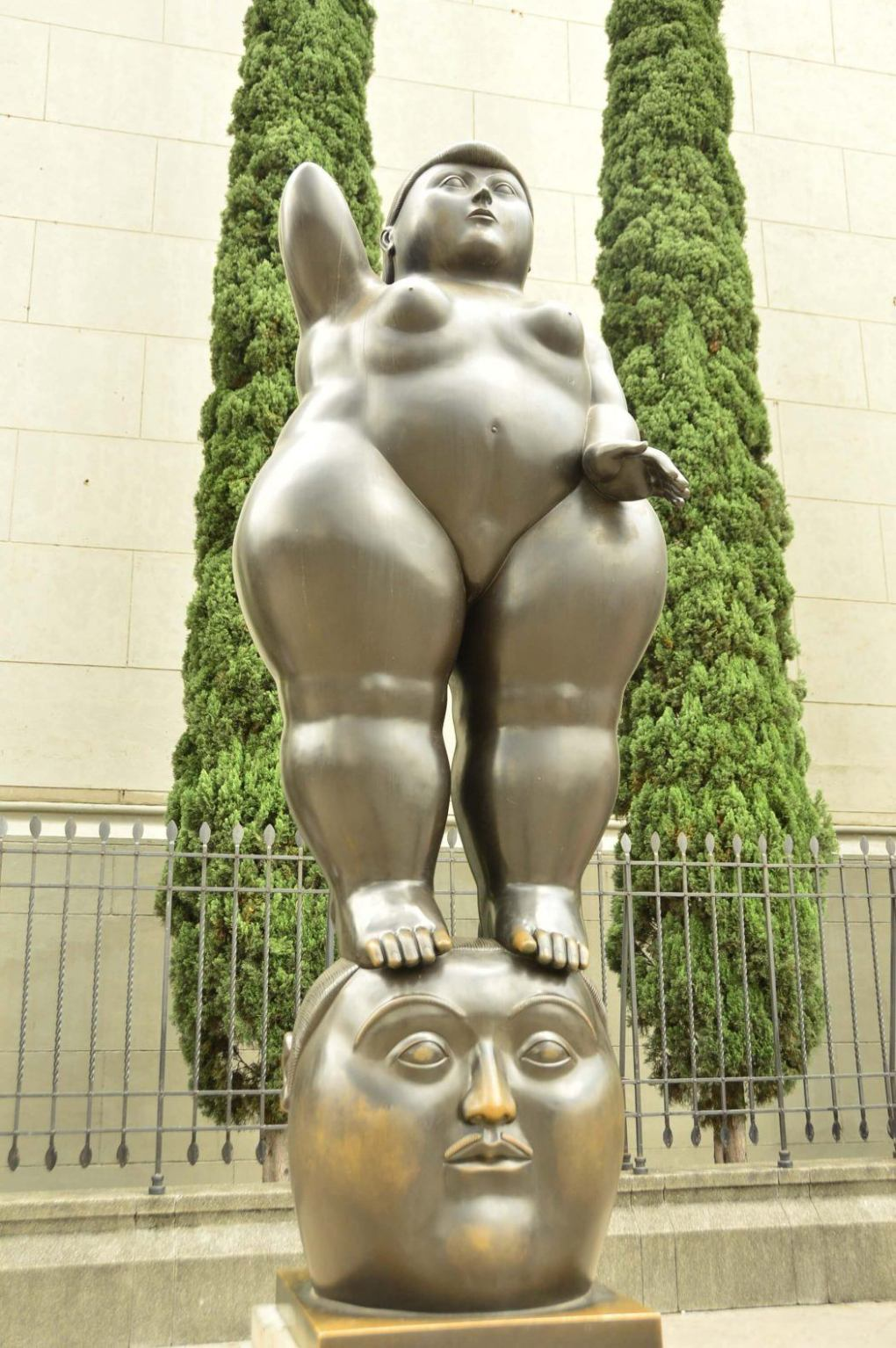 botero sculputre of naked woman standing on head