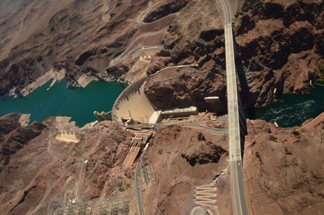 2 days in Vegas by myself.. what should I do that isn't typical Vegas? Flying-over-the-Hoover-Dam-e1520101727517
