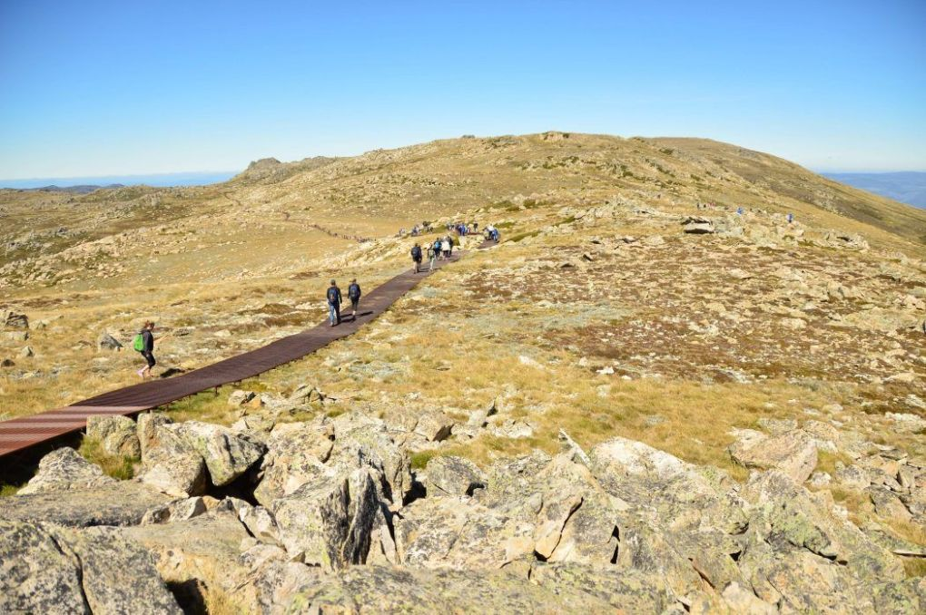 people walking to the summit of Mount Kosciuszko - a great weekend getaway from Sydney