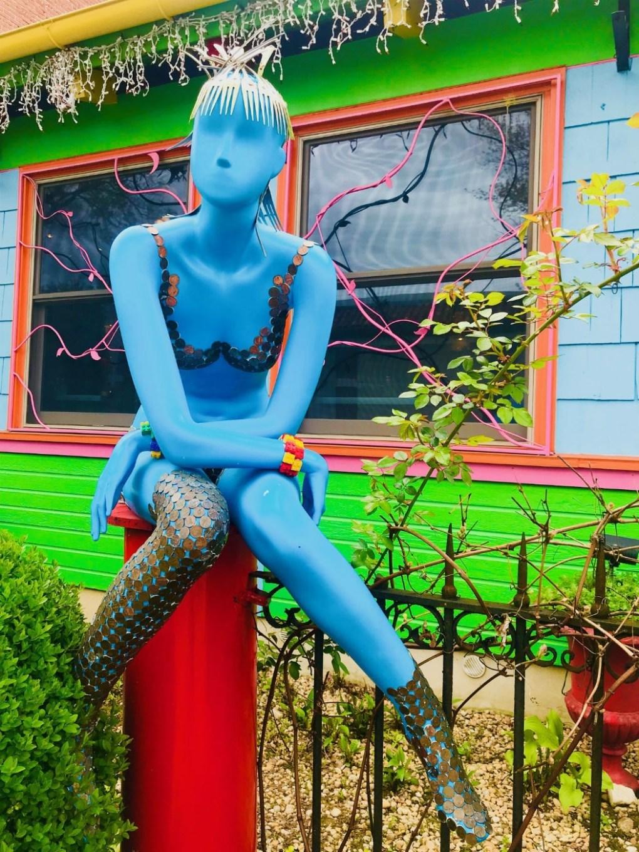 paper moon diner blue woman sculpture