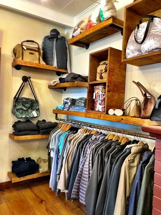 inside the gift shop at kwandwe safari showing shirts hanging up