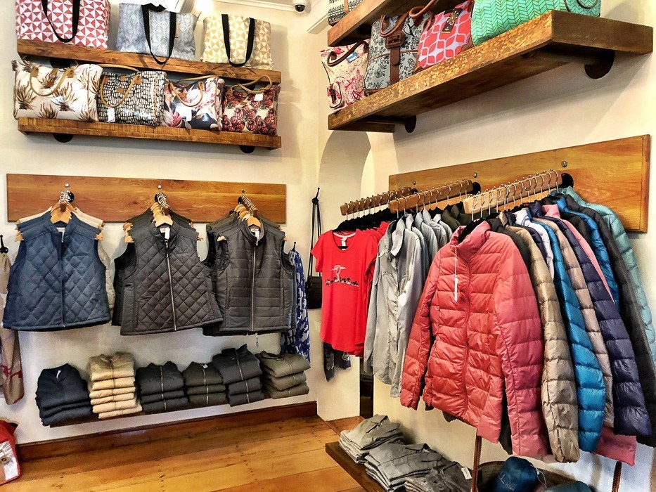puffer vests and jackets merchandised at the shop at kwandwe south africa