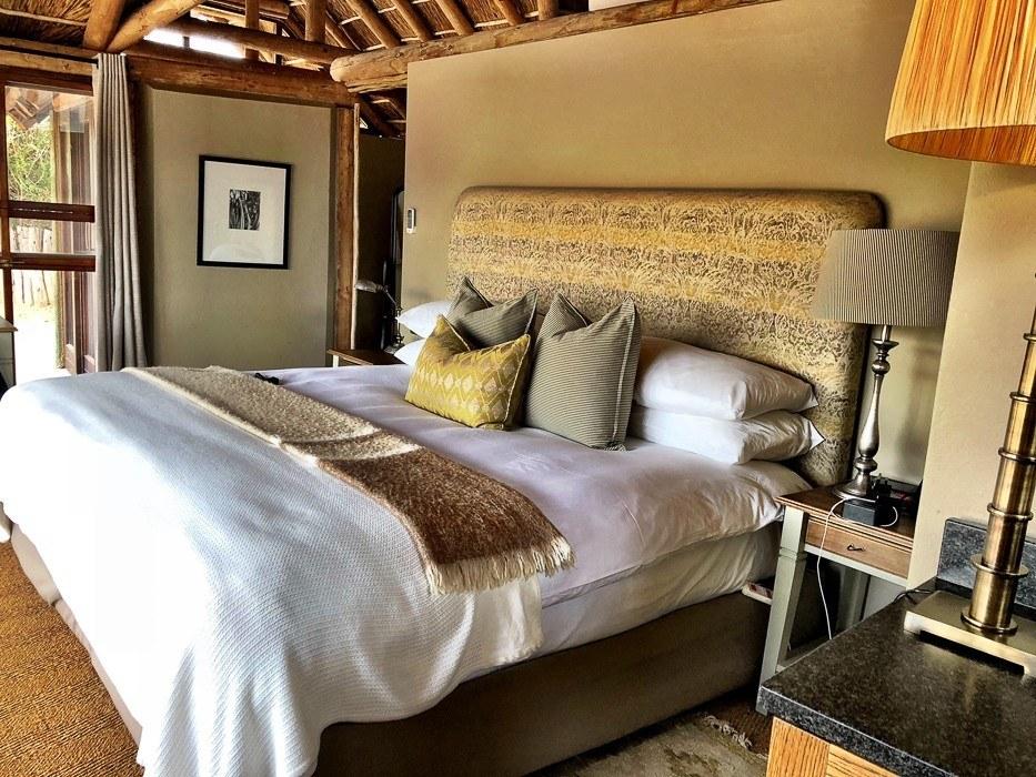 bedroom and bed at Kwandwe safari lodge south africa