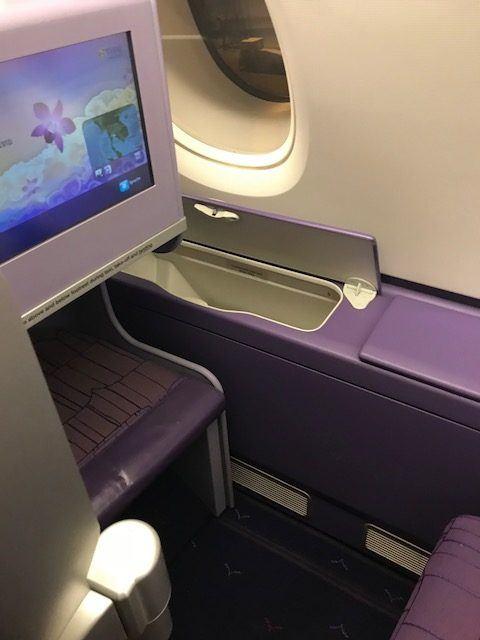 thai airways a380 business class in plane screen and storage locker