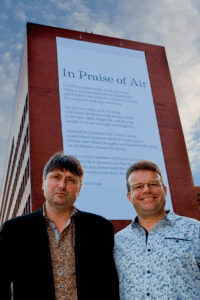 "Installation of the ""photocatalytic poem"", In Praise of Air, in Sheffield. Present are Simon Armitage (right), and Prof. Tony Ryan (left). Photo from www.sheffield.ac.uk."