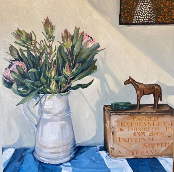 Oil painting depicting a bouquet of pink flowers in a white jug next to a tea box with a horse figurine standing on top.