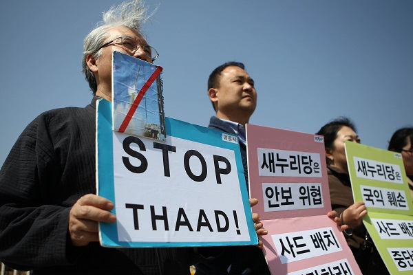 South Korean protesters hold placards during a rally against the deployment of the advanced U.S. missile defense system on the Korean Peninsula, called Terminal High-Altitude Area Defense (THAAD), in front of the National Assembly in Seoul, South Korea, April 1, 2015 [Xinhua]